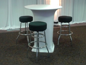 Chrome bar stools at cocktail table