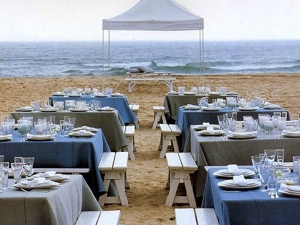 Natural wood benches at the beach wedding
