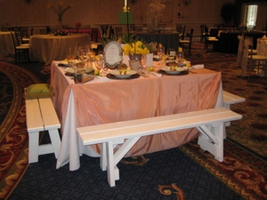 White wood benches at the table