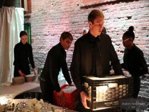 Waiters setup the ballroom