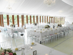 Ghost Chiavari chairs under tent setup