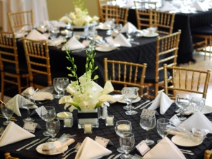 Gold Chiavari chairs at event tables