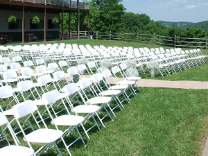 White plastic folding chairs setup